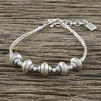 Silver beaded bracelet, 'Roll On By' - Combination Finish Silver Beaded Bracelet from Thailand