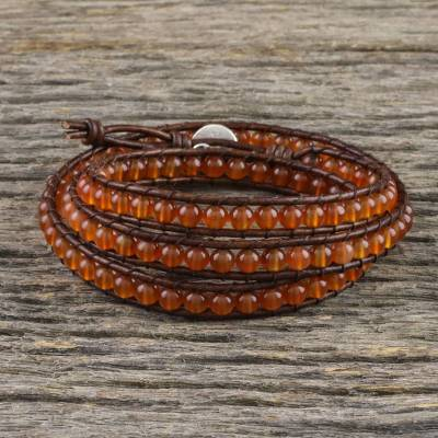 Carnelian beaded wrap bracelet, 'Spring Fire' - Carnelian and Leather Beaded Wrap Bracelet from Thailand