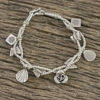 Silver beaded charm bracelet, 'Karen Freedom' - Floral and Animal-Themed Beaded Charm Bracelet from Thailand