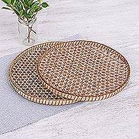 Bamboo and rattan trays, 'Presenting Pikul' (10 and 11 inch, pair) - Set of 2 Handcrafted Woven Flower Motif Thai Rattan Trays