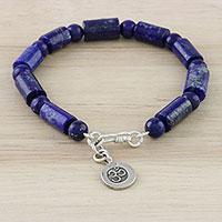 Lapis lazuli beaded bracelet, 'Oceanic Om' - Lapis Lazuli Om Beaded Bracelet from Thailand