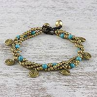 Calcite beaded charm bracelet, 'Delightful Spirals' - Calcite and Brass Beaded Charm Bracelet from Thailand