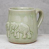 Celadon ceramic mug, 'Playful Elephants' - Elephant-Themed Celadon Ceramic Mug from Thailand