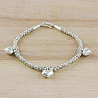 Silver beaded charm bracelet, 'Triple Hearts' - 950 Karen Hill Tribe Silver Beaded Heart Charm Bracelet