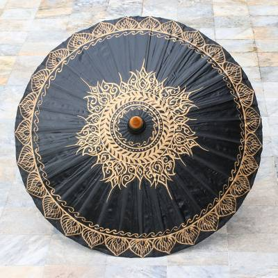 Cotton parasol, 'Black Gold Sun' - Black and Gold Oil Painted Thai Parasol with Bamboo Frame
