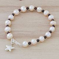 Cultured pearl and garnet beaded bracelet, 'Starfish Love' - Beaded Cultured Freshwater Pearl Garnet Starfish Bracelet