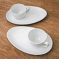 Ceramic cups and snack plates, 'Snow White' (set for two) - Artisan Crafted White Ceramic Set of Two Cup and Snack Plate