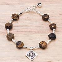 Tiger's eye and silver charm bracelet, 'Chiang Mai Snowflake' - Tiger's Eye and Hill Tribe Silver Beaded Bracelet