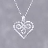 Sterling silver pendant necklace, 'Heart Twist' - Artisan Crafted Sterling Silver Heart Necklace from Thailand