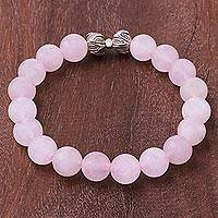 Rose quartz beaded stretch bracelet, 'Leafy Pink' - Leaf-Themed Rose Quartz Beaded Stretch Bracelet