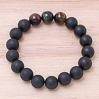 Onyx and tiger's eye beaded stretch bracelet, 'Dark as Night' - Onyx and Tiger's Eye Beaded Stretch Bracelet from Thailand