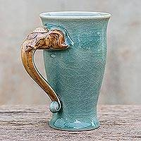 Celadon ceramic mug, 'Elephant Handle in Green' - Elephant-Themed Celadon Ceramic Mug from Thailand