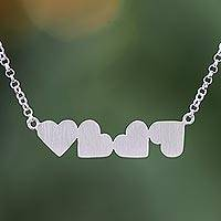 Sterling silver pendant necklace, 'Four Hearts' - Heart Motif Sterling Silver Pendant Necklace from Thailand