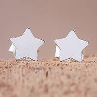Sterling silver stud earrings, 'Simple Stars' - Star-Shaped Sterling Silver Stud Earrings from Thailand