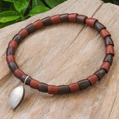 Sterling silver and wood beaded pendant necklace, 'Fascinating Leaf' - Sterling Silver and Wood Beaded Pendant Necklace