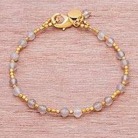 Agate beaded bracelet, 'Captured Clouds' - Brass and Grey-White Faceted Agate Bead Charm Bracelet
