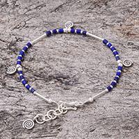Lapis lazuli beaded charm bracelet, 'Spiral Blue' - Spiral Motif Lapis Lazuli Beaded Charm Bracelet