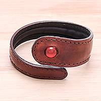Men's carnelian and leather wrap bracelet, 'Rugged Solitaire' - Men's Brown Leather and Carnelian Bead Tapered Wrap Bracelet