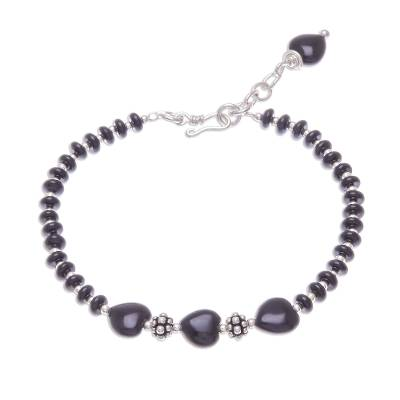 Onyx beaded bracelet, 'Midnight Love' - Heart-Themed Black Onyx Beaded Bracelet from Thailand