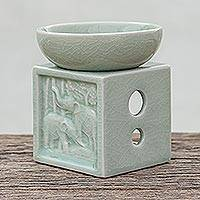 Celadon ceramic oil warmer, 'Elephant Jungle' - Elephant-Themed Celadon Ceramic Oil Warmer from Thailand
