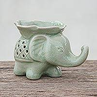 Celadon ceramic oil warmer, 'Elephant and Leaf' - Celadon Ceramic Elephant Oil Warmer from Thailand