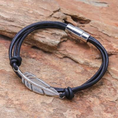 Stainless steel and leather pendant bracelet, 'Stunning Feather in Black' - Stainless Steel and Black Leather Feather Pendant Bracelet