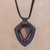 Tiger's eye pendant necklace, 'Bold Shield' - Tiger's Eye and Leather Pendant Necklace from Thailand