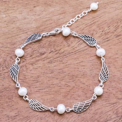 Cultured pearl link bracelet, 'Flying Free' - Thai Handcrafted Cultured Pearl Bracelet with Silver Wings