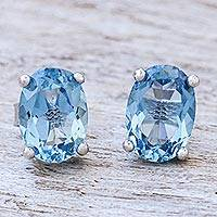 Blue topaz stud earrings, 'London Ovals' - Faceted Blue Topaz Stud Earrings from Thailand