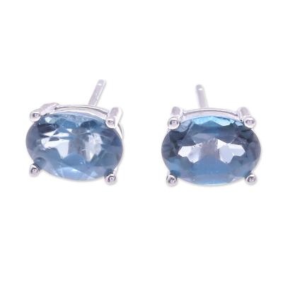 Blue topaz stud earrings, 'London Ovals' - Faceted Blue Topaz Stud Earrings from Thailand