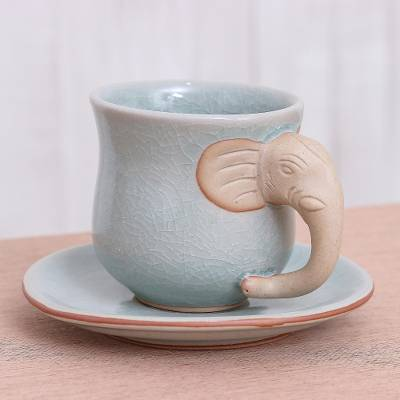 Celadon ceramic cup and saucer, 'Elephant Gaze' - Aqua Celadon Cup and Saucer with Elephant Motif