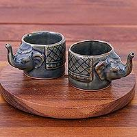 Celadon ceramic teacups, 'Elephant Essence in Brown' (pair) - Handmade Brown Celadon Ceramic Elephant Teacups (Pair)