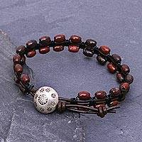 Jasper and leather beaded bracelet, 'Pa Sak Shadows' - Dark Red Jasper and Brown Leather Beaded Bracelet