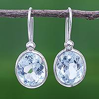 Blue topaz dangle earrings, 'Noonday Sky' - Oval Faceted Blue Topaz Sterling Silver Dangle Earrings