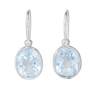 Blue topaz dangle earrings, 'Noonday Sky' - Oval Faceted Blue Topaz Sterling Silver Dangle Earrings