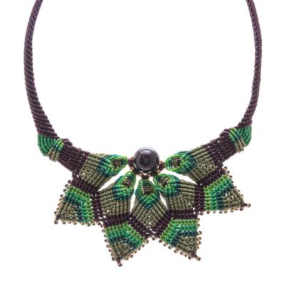 Garnet macrame pendant necklace, 'Bohemian Star' - Garnet Macrame Pendant Necklace from Thailand