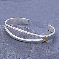 Sterling silver cuff bracelet, 'Two Roads Diverge' - High-Polish Sterling Silver Cuff Bracelet with Brass Accent
