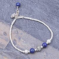 Lapis lazuli beaded bracelet, 'Flora Bead in Blue' - Hand Threaded Sterling Silver Lapis Lazuli Beaded Bracelet