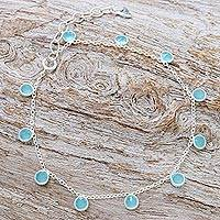 Chalcedony and blue topaz charm bracelet, 'Yearning in Blue' - Hand Crafted Chalcedony and Blue Topaz Charm Bracelet