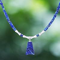 Lapis lazuli pendant necklace, 'Shrouded Origins' - Hand Made Sterling Silver and Lapis Lazuli Pendant Necklace