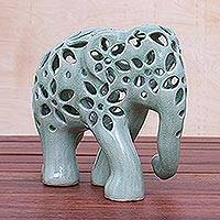 Celadon ceramic sculpture, 'Flowering Elephant' - Hand Crafted Celadon Ceramic Elephant Sculpture