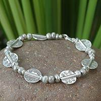 Silver charm bracelet, 'Mystic Origins' - Unique Sterling Silver Bracelet from Hill Tribes of Thailand