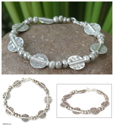 Silver charm bracelet, 'Mystic Origins' - Handcrafted Hill Tribe 950 Silver Bracelet